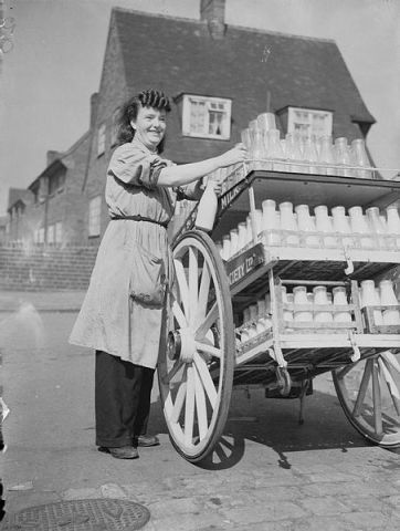Women_Deliver_the_Milk_in_Wartime,_Leeds,_England,_C_1942_D8760