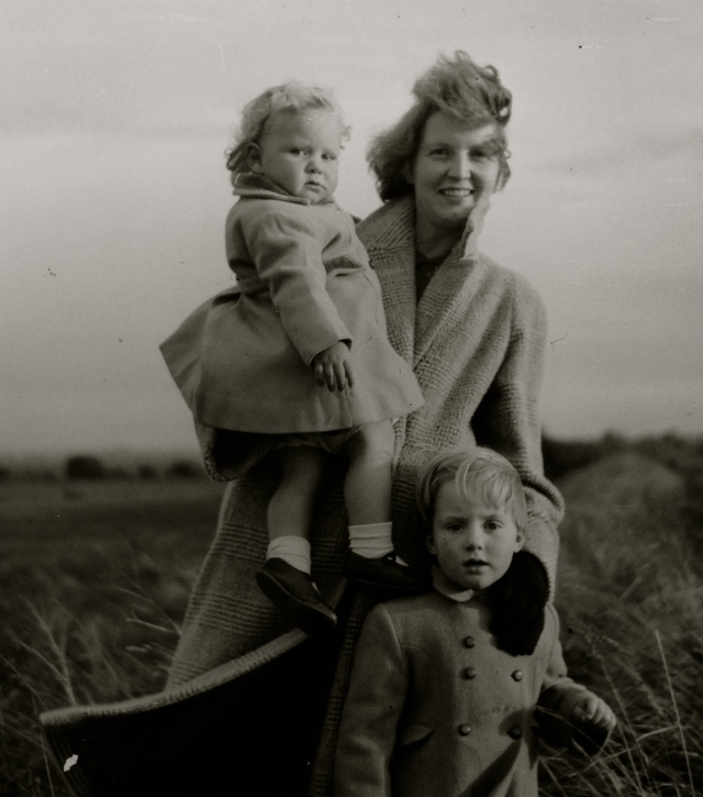 The author being held by her mother, and her sister, circa 1957