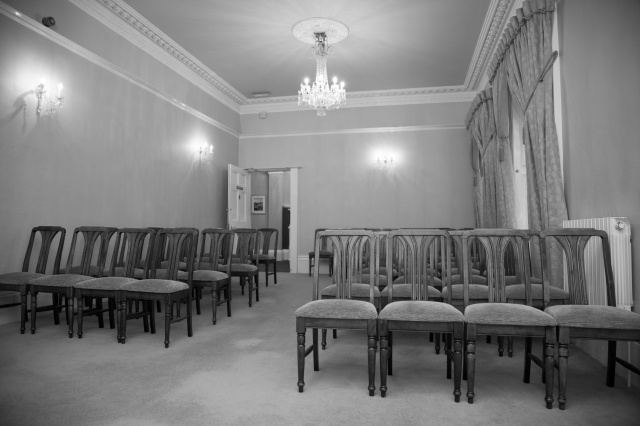 chair-sits-in-an-empty-room-14732389437xu
